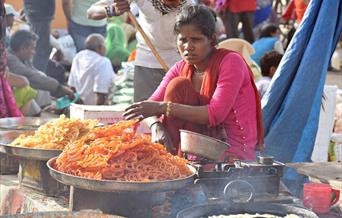 Indian women selling traditional sweets